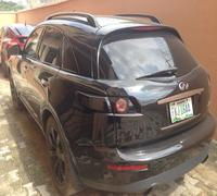 2005  features: fx 45 for sale Nigeria used LEATHER SEAT  DVD/FM,6 CD CHANGER  NAVIGATION SYSTEM  REVERSE CAMERA  ALLOY WHEELS  AUTOMATIC TRANSMISSION  FACTORY FITTED AC  POWER DOORS  POWER WINDOWS  AUTOMATIC BRAKING SYSTEM.  LOW MILEAGE : 83064  SRS AIRBAGS INTACT.  V8 ENGINE.  SPARE TYRE  CENTRAL LOCK  Its in a perfect condition. Price: #1.9m asking price.